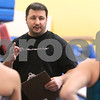 Kyle Bursaw – kbursaw@daily-chronicle.com<br /> <br /> DeKalb gymnastics coach Andrew Morreale talks to his team as they transition between different activities at Energym in Sycamore, Ill. on Tuesday, Dec. 21, 2010.