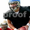 Rob Winner – rwinner@daily-chronicle.com<br /> <br /> Quarterback Ryan Bartels looks to handoff during the Spartans first practice on Wednesday August 11, 2010 in Sycamore, Ill.