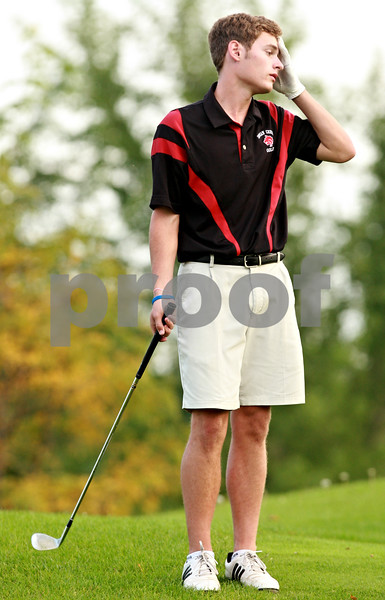 Beck Diefenbach – bdiefenbach@daily-chronicle.com<br /> <br /> Indian Creek's Alex Bremner reacts after a putt on the 17th green during the Little 10 Conference Meet at the Hughes Creek Golf Course in Elburn, Ill., on Wednesday Sept. 22, 2010.