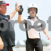 Rob Winner – rwinner@daily-chronicle.com<br /> <br /> Kaneland coach Brian Willis congratulates Delani Vest after she reached third base in the fifth inning of the IHSA Class 3A Sycamore Regional championship game on Saturday May 29, 2010 in Sycamore, Ill. Sycamore went on to defeat Kaneland, 6-3.