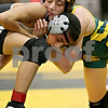 Rob Winner – rwinner@daily-chronicle.com<br /> Nick Fontanetta (top), of Crystal Lake South, goes up against Esai Ponce, of Kaneland, during their 103-pound semifinal match at the Sycamore Wrestling Invitational in Sycamore, Ill. on Saturday January 9, 2010.