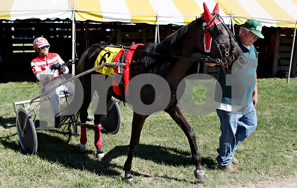 Rob Winner  -  rwinner@daily-chronicle.com<br /> <br /> Driver Tom Busse (left), of Kirkland, is helped by Bill Croegaert, of Kewanee, with horse Cooper Doll before the start of the first harness race at the Sandwich Fair in Sandwich, Ill. on Wednesday September 8, 2010.