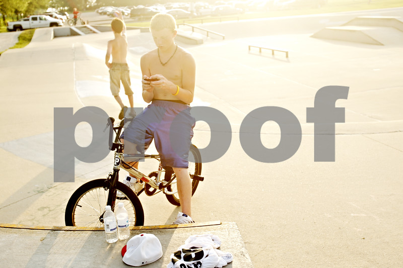 Beck Diefenbach  -  bdiefenbach@daily-chronicle.com<br /> <br /> Jacob Nolan, 13, came from Ottowa to ride his bike at the skate park in Katz Park in DeKalb, Ill., on Wednesday July 14, 2010.