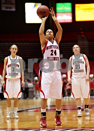 Beck Diefenbach  -  bdiefenbach@daily-chronicle.com<br /> <br /> Northern Illinois' Sarah Rogers (24, center) shoots the second of three free-throw shots to take the lead at the end of the first half of the game against Central Michigan at the NIU Convocation Center in DeKalb, Ill., on Wednesday Jan. 20, 2010