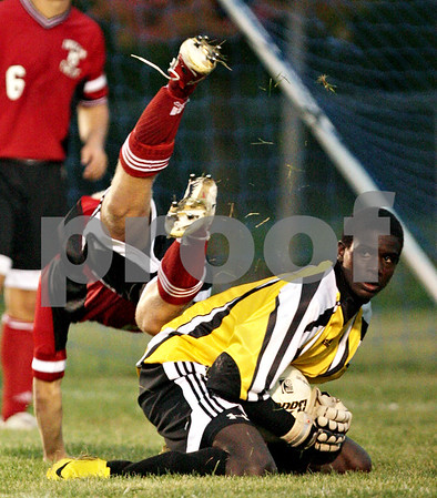 Beck Diefenbach – bdiefenbach@daily-chronicle.com<br /> <br /> Indian Creek's Matt Kyler (8, top) flies over Indian Creek goalie Shaquille Crayton during the first half of the game against Hinckley-Big Rock at Hinckley-Big rock High School in Hinckley, Ill., on Monday Sept. 20, 2010.