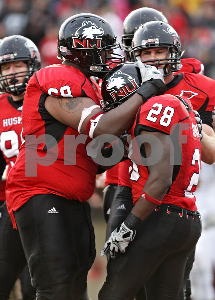 Rob Winner – rwinner@daily-chronicle.com<br /> <br /> Northern Illinois' Keith Otis congratulates teammate Chad Spann after Spann's third touchdown of the day during the fourth quarter in DeKalb, Ill. on Saturday October 23, 2010. DeKalb went on to defeat Central Michigan, 33-7.