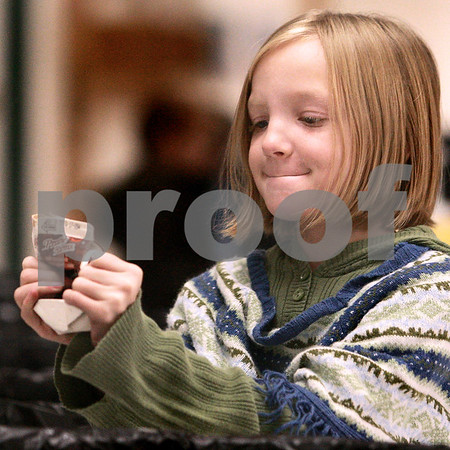 Kyle Bursaw – kbursaw@daily-chronicle.com<br /> <br /> Kaylee O'Bed, 8, squishes her milk carton before tossing it into the recycling at West Elementary school in Sycamore, Ill. on Nov. 18, 2010.