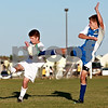 Beck Diefenbach – bdiefenbach@daily-chronicle.com<br /> <br /> Genoa-Kingston's Matt Devine (12, left) and Rockford Christian's Cody Mech (20) battle for the ball during the second half of the game at G-K High School in Genoa, Ill., on Thursday Sept. 30, 2010. G-K defeated Rockford Christian 1 to 0.