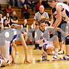Beck Diefenbach  -  bdiefenbach@daily-chronicle.com<br /> <br /> Hinckley-Big Rock's Kaitlin Phillips (14, center) is helped up by Jenna Thorp (20, right) after multiple players fall to the ground during the second quarter of the Little 10 Tournament semi-final game against Indian Creek at H-BR in Hinckley, Ill., on Thursday Jan. 21, 2010. H-BR defeated Indian Creek 69 to 34.