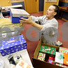 Rob Winner – rwinner@daily-chronicle.com<br /> <br /> At First Baptist Church of Sycamore on Monday afternoon, volunteers for Operation Christmas Child, including Deb Byrd, loads a shipping box with smaller boxes filled with gifts which will be distributed to millions of children throughout the world for Christmas.