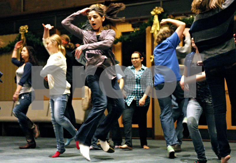 "Rob Winner – rwinner@daily-chronicle.com<br /> <br /> Cast members including Eliza Coran, 12 of DeKalb, practice a dance move during rehearsal for ""Thoroughly Modern Millie"" at Westminster Presbyterian Church in DeKalb on Monday night."