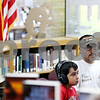 Rob Winner – rwinner@daily-chronicle.com<br /> <br /> Genoa residents David Soto Jr. (left), 7, and his father David Soto, use the computers at the Genoa Public Library in Genoa, Ill. on Saturday August 14, 2010.