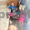 Beck Diefenbach  -  bdiefenbach@daily-chronicle.com<br /> <br /> As smoke fills the room, Matthew Maher (top), 8, of DeKalb, drops to the floor with other children during a fire safety demonstration at the National Night Out event held in the parking lot of Target in DeKalb, Ill., on Tuesday Aug. 3, 2010.