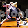 Rob Winner – rwinner@daily-chronicle.com<br /> <br /> DeKalb's Doug Johnson (top) goes up against Kaneland's Dan Goress in the 130-pound match at DeKalb on Thursday night. Johnson won the match by decision for the Barbs.