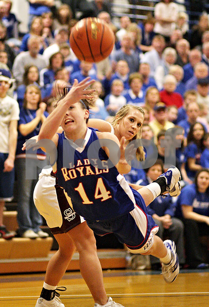 Beck Diefenbach  -  bdiefenbach@daily-chronicle.com<br /> <br /> Hinckley-Big Rock's Kaitlin Phillips (14, left) passes the ball after she strips over Stockton's Morgan Werkheiser (32, right) during the third quarter of the IHSA Class 1A Super Sectional championship game at Judson University in Elgin, Ill., on Monday Feb. 22, 2010.