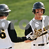 Beck Diefenbach  -  bdiefenbach@daily-chronicle.com<br /> <br /> Sycamore's John Copple  (12, left) congratulates eric Ray (5, right) after scoring a run during the the fourth inning of the game against Batavia at Sycamore Park in Sycamore, Ill., on Wednesday April 21, 2010. Batavia defeated Sycamore 4 to 2.
