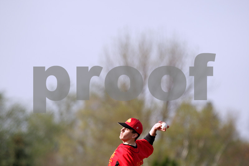 Beck Diefenbach  -  bdiefenbach@daily-chronicle.com<br /> <br /> Batavia pitcher Matt Taylor (19) winds up during the second inning of the game against DeKalb at DeKalb High School in DeKalb, Ill., on Thursday April 15, 2010. Batavia defeated DeKalb 7 to 4.