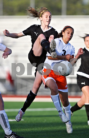 Beck Diefenbach  -  bdiefenbach@daily-chronicle.com<br /> <br /> Sycamore's Lauren Miller (17, left) collides with DeKalb's Jassmine Marquez (3) while battling for the ball during the second half of the game at Northern Illinois University in DeKalb, Ill., on Thursday April 29, 2010. Sycamore defeated DeKalb 2 to 0.