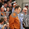 Beck Diefenbach - bdiefenbach@daily-chronicle.com<br /> <br /> Kaneland's head coach Brian Johnson (back) reacts to a decision by the referee (far right) as DeKalb head coach David Rohlman stands by during the fourth quarter of the IHSA Class 3A Regional championship game against DeKalb at Kaneland High School in Maple Park, Ill., on Friday March 3, 2010.