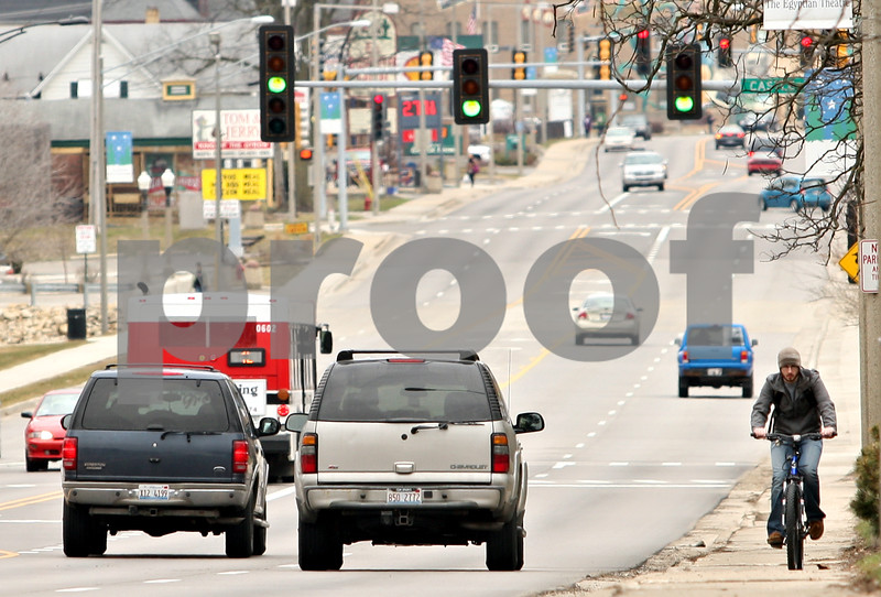 Beck Diefenbach  -  bdiefenbach@daily-chronicle.com<br /> <br /> A cyclist travels along West Lincoln Highway in DeKalb, Ill., on Monday March 15, 2010.