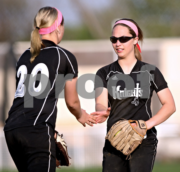 Beck Diefenbach  -  bdiefenbach@daily-chronicle.com<br /> <br /> Kaneland's Delaney Vest (1, right) and McKinzie Mangers (20) congratulate each other during the fifth inning of the game at Sycamore High School in Sycamore, Ill., on Tuesday April 20, 2010. Kaneland defeated Sycamore 10 to 0 in six innings.