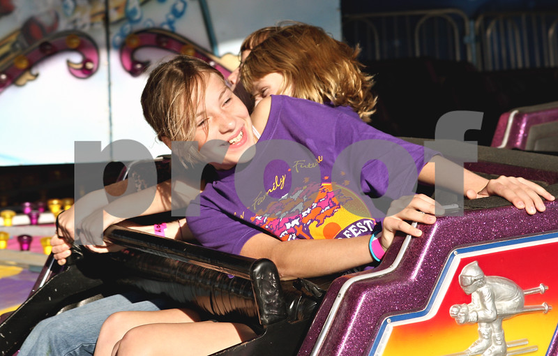 Rob Winner – rwinner@daily-chronicle.com<br /> <br /> Cortland resident Abbie Shows (sp), 10, rides the Himalaya during September Fest at St. Mary's School in DeKalb, Ill. on Friday September 24, 2010.