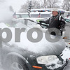 Rob Winner – rwinner@daily-chronicle.com<br /> Owner Mike Cretsinger, of Genoa Motors in Genoa, Ill., uses a blower to remove the snow from the cars on his lot on the morning of Thursday January 7, 2010.