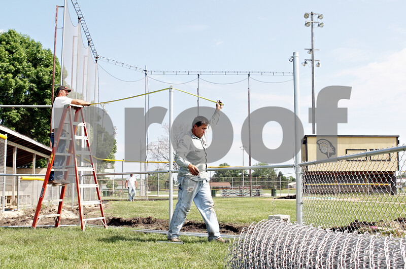 Rob Winner –  rwinner@daily-chronicle.com<br /> <br /> Stanley McGinnis (left) and Jose Becerra take a measurement before installing new fencing around the baseball field at Sycamore Community Park on Thursday May 27, 2010 in Sycamore, Ill.