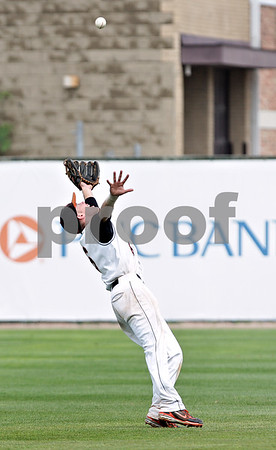 Beck Diefenbach  -  bdiefenbach@daily-chronicle.com<br /> <br /> DeKalb's Kevin Sullivan catches a pop fly during the sixth inning of the IHSA Class 3A State Semifinal Game against Marian Central in Joliet, Ill., on Friday June 11, 2010.