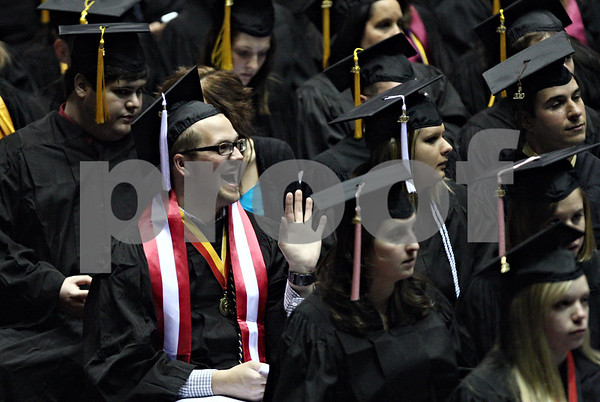 Rob Winner – rwinner@daily-chronicle.com<br /> <br /> Thomas Graff, of Antioch, waves to a fellow Northern Illinois University graduate during Saturday's graduation ceremony at the Convocation Center in DeKalb, Ill. on May 8, 2010.