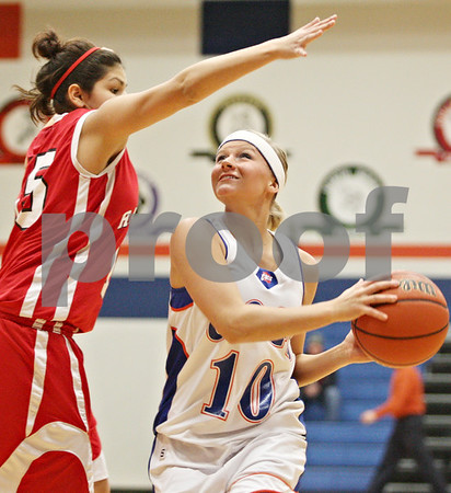 Rob Winner – rwinner@daily-chronicle.com<br /> <br /> Mooseheart's Cayana Samuelson (left) pressures Genoa-Kingston forward Ashley Miller during the first quarter in Genoa on Wednesday night.