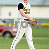 Beck Diefenbach  -  bdiefenbach@daily-chronicle.com<br /> <br /> Sycamore's Zack Spiewak (2, left) reacts to a ball call which filled the bases during the top of the seventh inning of the game against DeKalb at Sycamore Park in Sycamore, Ill., on Tuesday April 6, 2010.
