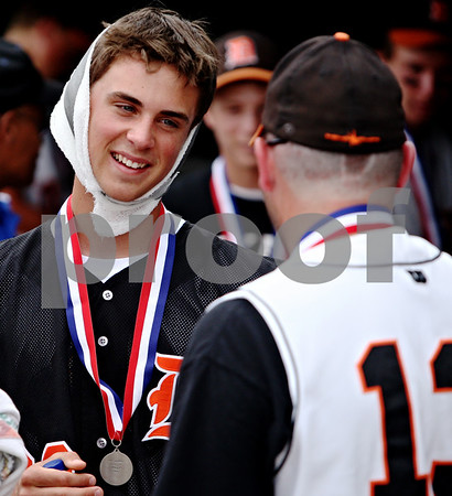 Rob Winner – rwinner@daily-chronicle.com<br /> <br /> Brian Sisler (left) who was injured the day before after a collision with teammate Jake Gordon (not pictured) talks with coach Paul Severino at the conclusion of the IHSA Class 3A championship in Joliet, Ill. on Saturday June 12, 2010. Chatham Glenwood defeated DeKalb, 11-1, in six innings.