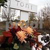 "Kyle Bursaw - kbursaw@daily-chronicle.com<br /> <br /> A white cross adorned with flowers stands behind the DeKalb Elk's Lodge as a memorial to NIU student Antinette ""Toni"" Keller."