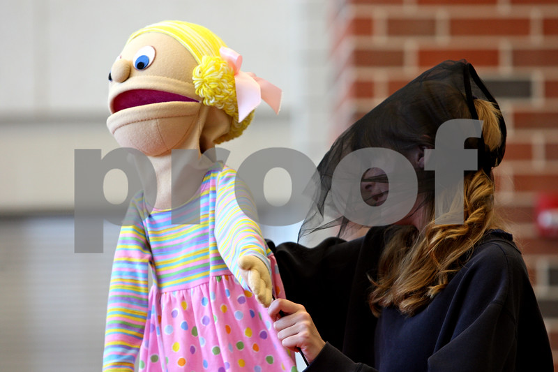 """Rob Winner – rwinner@daily-chronicle.com<br /> <br /> Alicia McConnell, of Sycamore High School, controls a puppet during an educational program called """"The Kids on the Block,"""" at North Grove Elementary School in Sycamore, Ill. on Wednesday May 19, 2010."""