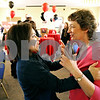 Rob Winner – rwinner@daily-chronicle.com<br /> <br /> After a hug, Michelle Bringas (left) talks with Nancy Kasinski during a retirement reception for Kasinski in the Sky Room at the Holmes Student Center in DeKalb, Ill. on Wednesday May 12, 2010. Kasinski is retiring on May 31 after 32 years at Northern Illinois University.
