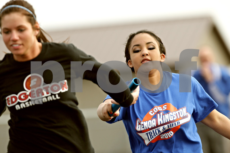 Beck Diefenbach  -  bdiefenbach@daily-chronicle.com<br /> <br /> Genoa-Kingston's Dakota Chandler (right) hands off the baton during track practice at Genoa-Kingston High School in Genoa, Ill., on Tuesday March 16, 2010.