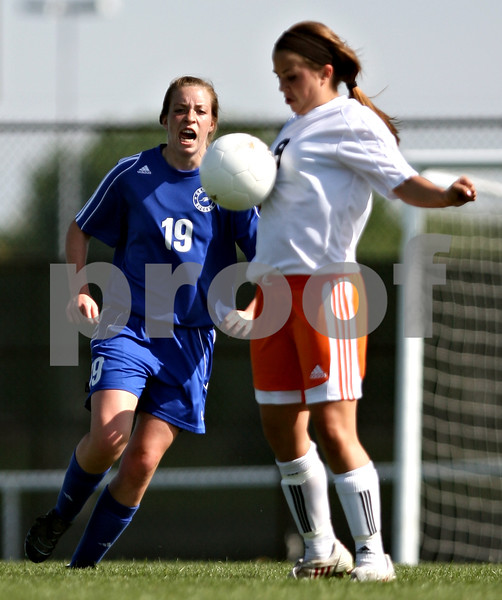 Beck Diefenbach  -  bdiefenbach@daily-chronicle.com<br /> <br /> Burlington Central Lindsey Puccio (19, left) watches as DeKalb's Alli Smith (9) stops the ball during the first half of the game at Rochelle Township High School in Rochelle, Ill., on Tuesday May 18, 2010. DeKalb defeated Burlington Central 4 to 2.