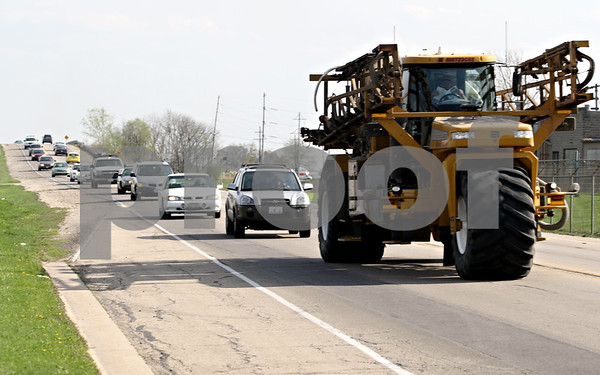 Beck Diefenbach  -  bdiefenbach@daily-chronicle.com<br /> <br /> Vehicles drive northbound on Peace Road just north of East Lincoln Highway in DeKalb, Ill., on Thursday April 15, 2010.