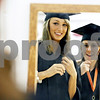 Rob Winner – rwinner@daily-chronicle.com<br /> <br /> DeKalb High School graduating seniors Caroline Struthers (left) and Gabby Klenke use a mirror to get ready before their commencement ceremony at the Convocation Center in DeKalb, Ill. on Saturday June 6, 2010.