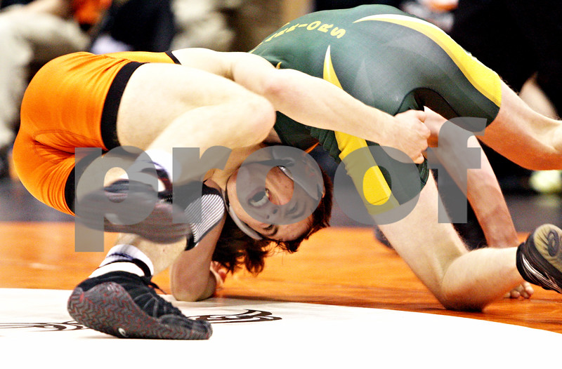 Rob Winner – rwinner@daily-chronicle.com<br /> <br /> DeKalb's Doug Johnson (left) goes up against Waubonsie Valley's Andy Myrna in the 125-pound match during the Doug Flavin wrestling tournament at DeKalb on Thursday night.