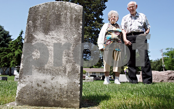 Rob Winner – rwinner@daily-chronicle.com<br /> <br /> On Thursday May 27, 2010 in Genoa, Ill., Ernest Pinne and his wife, Ida, visit the gravestone of Henry Pinne, Ernest's brother, who died while serving in World War II in 1945.