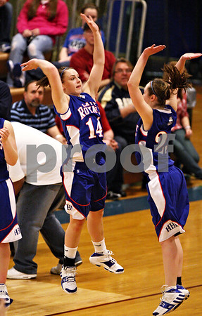 Beck Diefenbach  -  bdiefenbach@daily-chronicle.com<br /> <br /> Hinckley-Big Rock's Kaitlin Phillips (center) is welcomed to the floor by Alyssa Baunach before the start of the IHSA Class 1A Super Sectional championship game against Stockton at Judson University in Elgin, Ill., on Monday Feb. 22, 2010.
