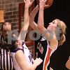 Kyle Bursaw – kbursaw@daily-chronicle.com<br /> <br /> DeKalb's Courtney Bemis shoots over a Hampshire defender in the second quarter. Hampshire defeated DeKalb 46-38 at DeKalb High School on Saturday, Nov. 27, 2010 during the Turkey Toss-Up tournament.