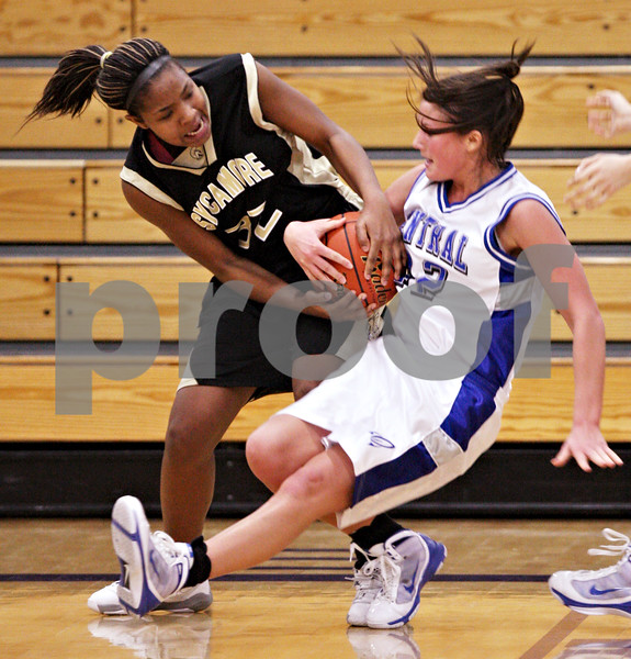Beck Diefenbach  -  bdiefenbach@daily-chronicle.com<br /> <br /> Sycamore's Montia Johnson (32, left) tears the ball from Burlington Central's   Taylor Colby (42) during the fourth quarter of the IHSA Class 3A Regional playoff game at Rochelle Township High School in Rochelle, Ill, on Monday Feb. 15, 2010.