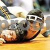 Rob Winner – rwinner@daily-chronicle.com<br /> <br /> Glenbard West's Jose Roman is held down by DeKalb's Evan Jones during their 130-pound quarterfinal match at the Don Flavin Tournament at DeKalb on Wednesday, Dec. 29, 2010.<br /> <br /> **Jones of DK won