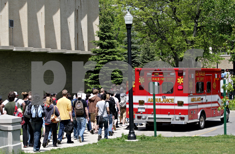 Beck Diefenbach  -  bdiefenbach@daily-chronicle.com<br /> <br /> Northern Illinois students, faculty and staff exit the area around Montgomery Hall as firefighter extinguish a fire in a lab on the fourth floor of the building on the campus of NIU in DeKalb, Ill., on Thursday May 6, 2010.