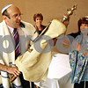 Beck Diefenbach – bdiefenbach@daily-chronicle.com<br /> <br /> Gary Schwartz, left, and Rabbi Mikki Mendelsohn, right, retire the Torah following the Rosh Hashanah service at Northern Illinois Holmes Student Center in DeKalb, Ill., on Friday Sept. 18, 2009.
