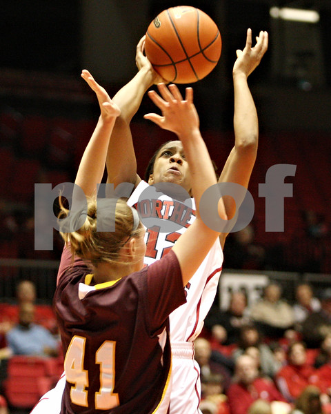 Rob Winner – rwinner@daily-chronicle.com<br /> <br /> Northern Illinois guard Danielle Pulliam puts up a shot over Loyola guard Katie Kortekamps during the first half in DeKalb, Ill. on Tuesday, Dec. 28, 2010.