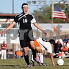 Rob Winner – rwinner@daily-chronicle.com<br /> <br /> Sycamore's Adam Westerby wants and receives a whistle during the first half in DeKalb, Ill. on Thursday October 7, 2010. DeKalb defeated Sycamore, 2-1.